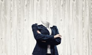 63977546 - headless businesswoman with arms crossed on chest on gray background